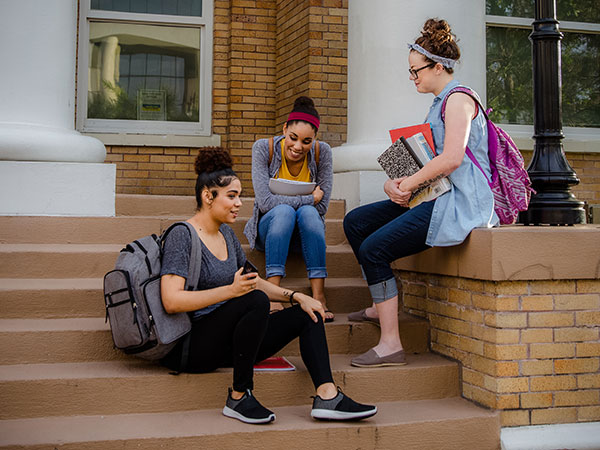 Teens sitting on steps